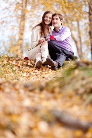 low contrast image of a happy romantic young couple spending time outdoor in the autumn park Stock Photo - 10794792