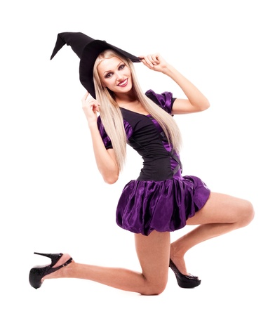 pretty sexy young blond woman dressed as a witch, isolated against white background photo