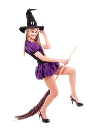 sexy halloween girl: pretty sexy young blond witch with a broom, isolated against white background