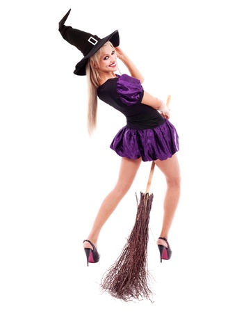 pretty sexy young blond witch with a broom, isolated against white background