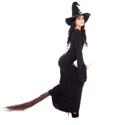 pretty sexy young brunette witch with a broom, isolated against white background photo