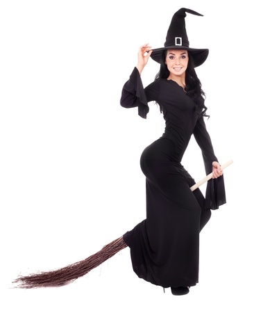 pretty  young brunette witch with a broom, isolated against white background photo