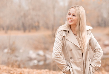 stylish women: beautiful young blond woman spending time in the autumn park   Stock Photo