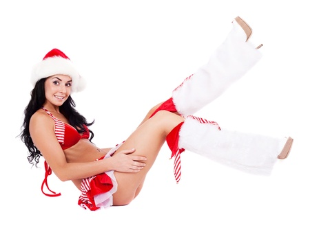 beautiful young brunette woman dressed as Santa, isolated against white background