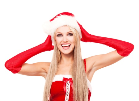 excited blond woman dressed as Santa, looking up, isolated against white background Stock Photo - 10944967