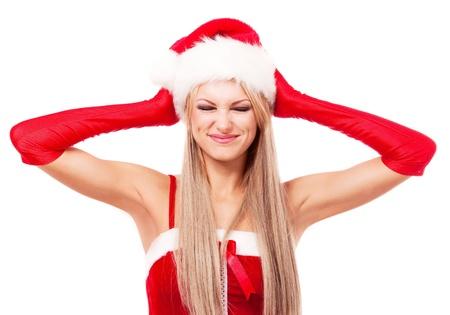 sexy santa m�dchen: mi�fiel Frau verkleidet als Weihnachtsmann und schloss ihre Ohren mit den H�nden und weigert sich, etwas zu h�ren, vor wei�em Hintergrund isoliert