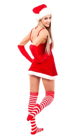 beautiful young blond woman dressed as Santa, isolated against white background photo