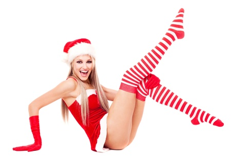 santa girl: beautiful young blond woman dressed as Santa, isolated against white background Stock Photo