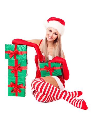 beautiful young blond woman dressed as Santa with many presents, isolated against white background photo