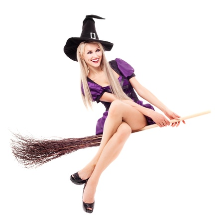 pretty  young blond witch flying on the broom, isolated against white background Stock Photo