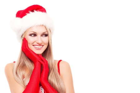 beautiful young blond woman dressed as Santa,looking to the right,  isolated against white background, copy place for your text to the right photo
