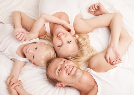 happy family; mother ,father and their son in  bed at home; top view Stock Photo - 10987238