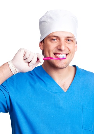 portrait of handsome young dentist teaching a patient to brush teeth, isolated against white background photo