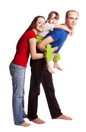 happy young family; mother, father and their daughter isolated against white background (focus on the woman) Stock Photo - 11076998