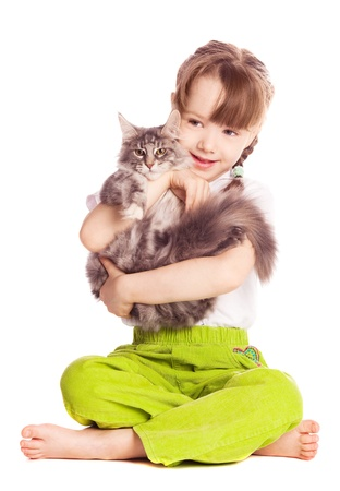 happy cute five year old girl  with her cat, isolated against white background photo