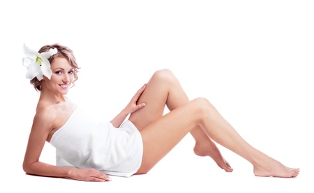 woman towel: beautiful young blond woman wrapped into the towel  with a lily in her hair
