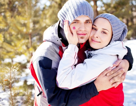 happy young couple spending time outdoor in the winter park Stock Photo - 11151476