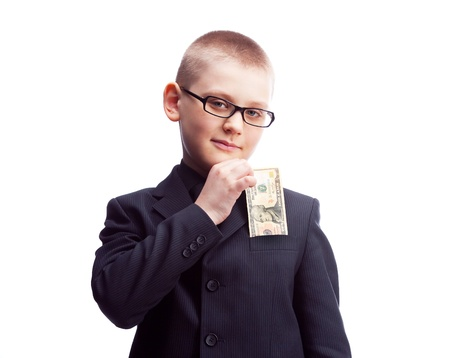 ten year old  confident boy wearing a costume putting ten dollars into his pocket photo