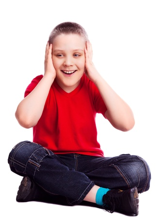 surprised ten year old  boy, isolated against white photo