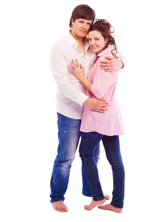 happy young loving couple, isolated against white background photo