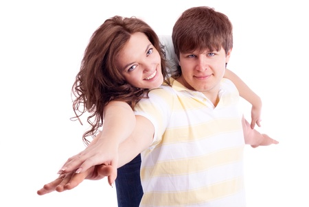 piggyback ride: happy young loving couple, isolated against white background