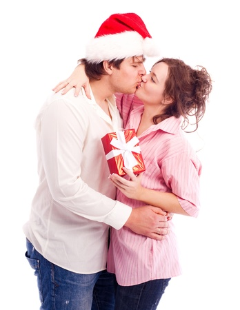 happy young couple, celebrating Christmas, isolated against white photo