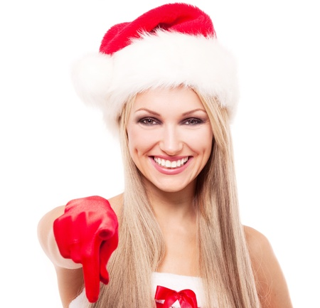 happy laughing blond woman dressed as Santa pointing at us, isolated against white background photo