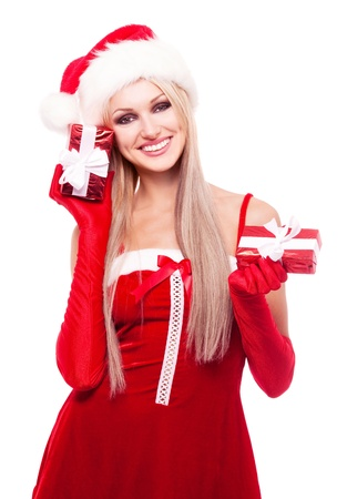beautiful happy blond woman dressed as Santa  holding presents in her hands, isolated against white background photo
