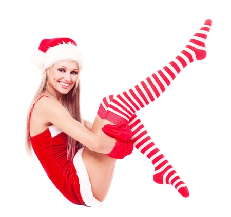 happy laughing blond woman dressed as Santa, isolated against white background photo