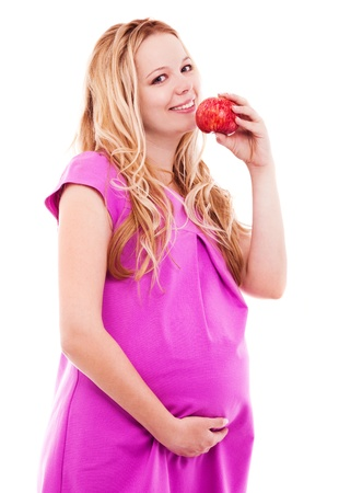 beautiful young pregnant woman with an apple, isolated against white background photo