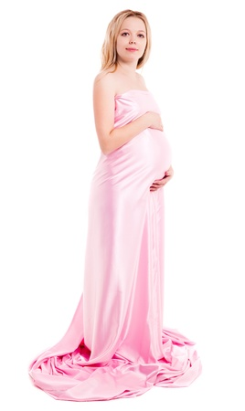 expectant mother: beautiful young pregnant woman wrapped into pink fabric, isolated against white background