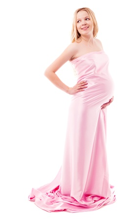 beautiful young pregnant woman wrapped into pink fabric, isolated against white background photo
