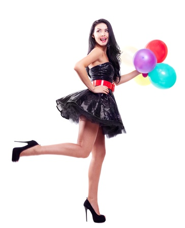 girl party: portrait of a beautiful young  woman holding balloons , isolated against white background Stock Photo