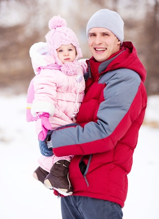 happy young father with his daughter spending time outdoor in the winter park  Stock Photo - 11557158