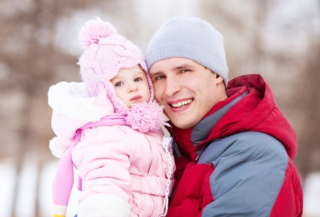 happy young father with his daughter spending time outdoor in the winter park Stock Photo - 11557151