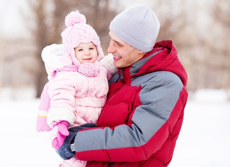 happy young father with his daughter spending time outdoor in the winter park Stock Photo - 11557157
