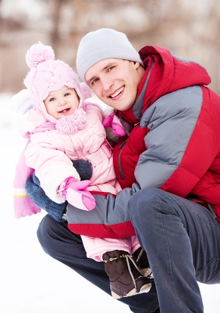 happy young father with his daughter spending time outdoor in the winter park Stock Photo - 11557155