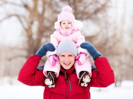 happy young father with his daughter spending time outdoor in the winter park Stock Photo - 11557152