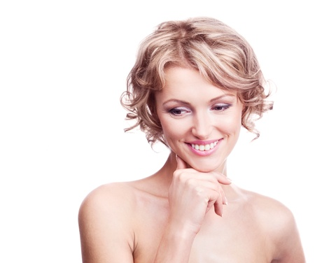 touch down: attractive thirty year old  woman with curly hair, looking down and smiling, isolated against white background