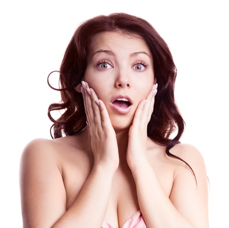 european expression face: portrait of a surprised young woman, isolated against white background