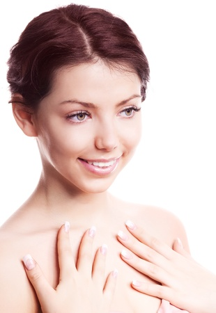 portrait of a young beautiful brunette woman touching her neck with hands, isolated against white background photo