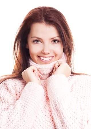 beautiful happy young woman wearing a high neck sweater, isolated against white background photo