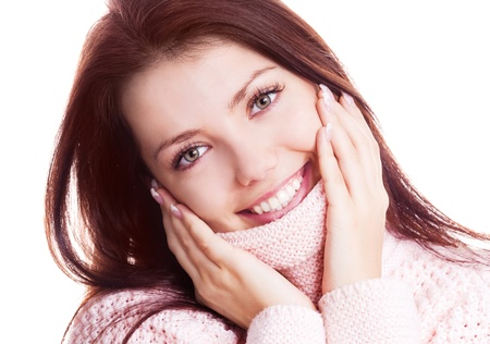 beautiful happy young woman wearing a high neck sweater, isolated against white background