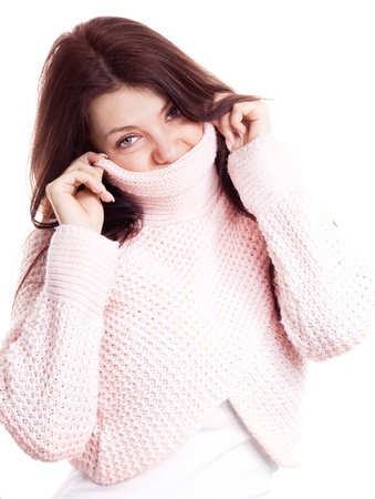 displeased young woman wearing a high neck sweater, isolated against white background photo