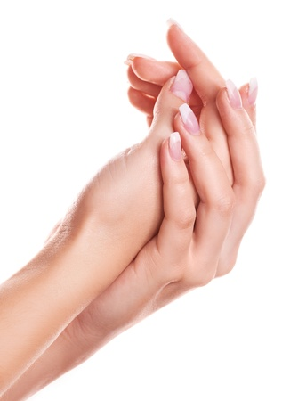 rubbing: hands of a woman applying body lotion, isolated against white background Stock Photo