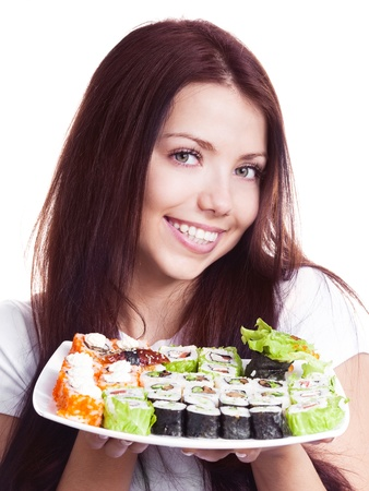 beautiful young woman holding a plate with sushi, isolated against white background photo