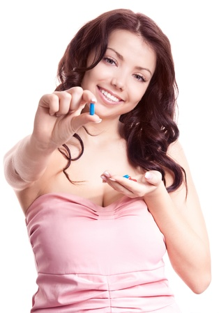 pretty young woman taking pills, isolated against white background (focus on the face) photo