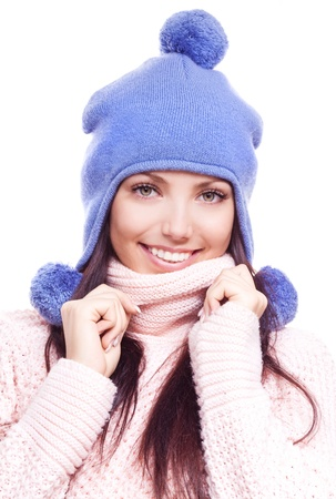 pom pom: beautiful happy young woman wearing a high neck sweater and a hat with pom-poms, isolated against white background Stock Photo