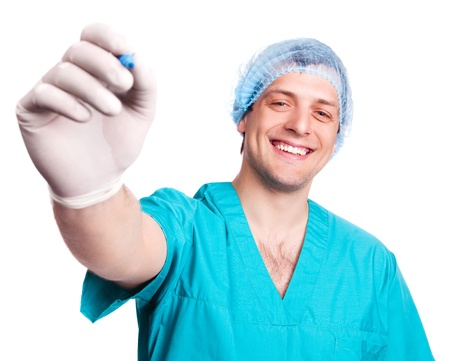 portrait of a surgeon with a pen writing something in the air, isolated against white background (focus on the face) photo