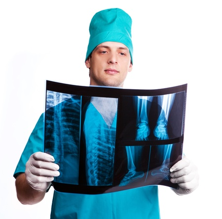roentgenogram: portrait of a surgeon looking at the x-ray photograph, isolated against white background Stock Photo